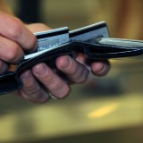 US_Navy_080918-N-0659H-001_A_Naval_Support_Activity_Mid-South_Sailor_takes_a_moment_to_decide_which_credit_card_to_use-1